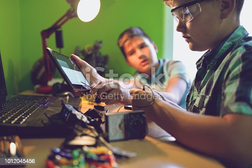 istock Little engineers! Look at this man, this will be a new and better version 1012045456