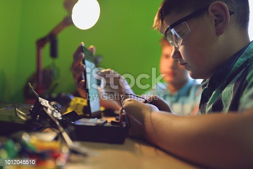 istock Little engineers! Look at this man, this will be a new and better version 1012045510