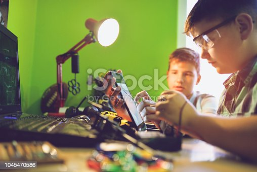 istock Little engineers! Look at this man, this will be a new and better version 1045470586