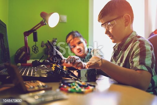 istock Little engineers! Look at this man, this will be a new and better version 1045470632