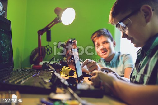 istock Little engineers! Look at this man, this will be a new and better version 1045473146