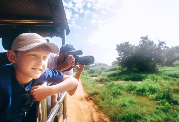 little expiorer boy with his father on safari - wildlife travel stock pictures, royalty-free photos & images