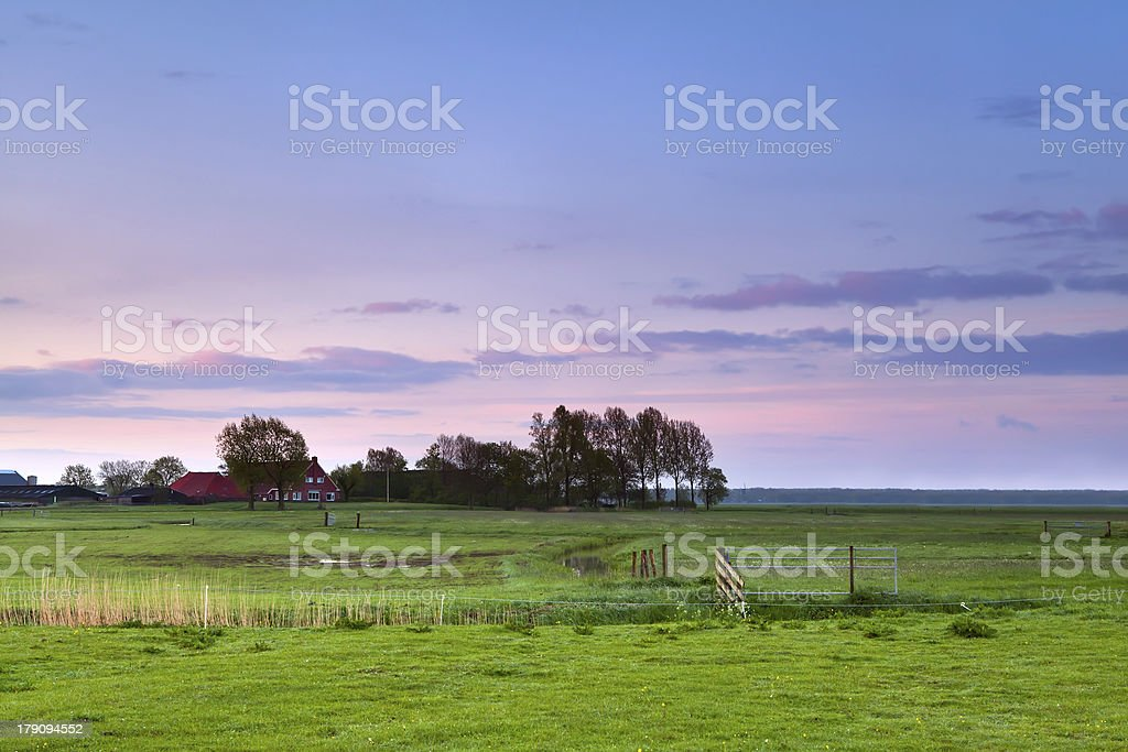 little farmhouse at pink sunrise royalty-free stock photo