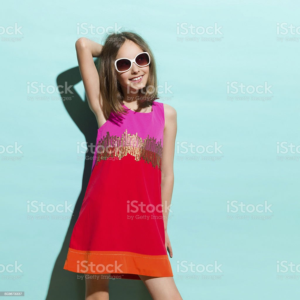 Little fashion girl posing in the sunlight stock photo