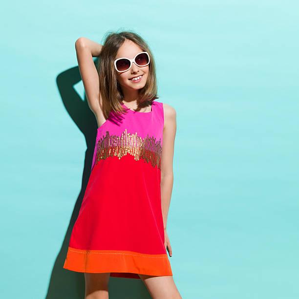 Little fashion girl posing in the sunlight stock photo