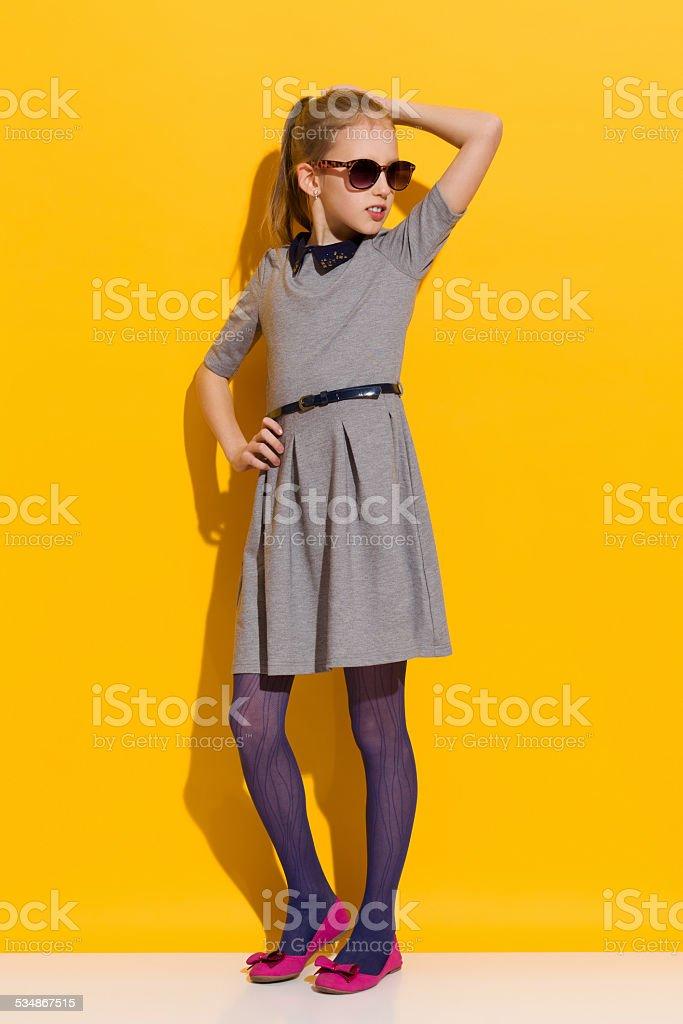 Little fashion model in gray dress stock photo