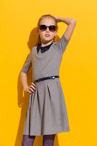 Little fashion model posing in the sunlight stock photo