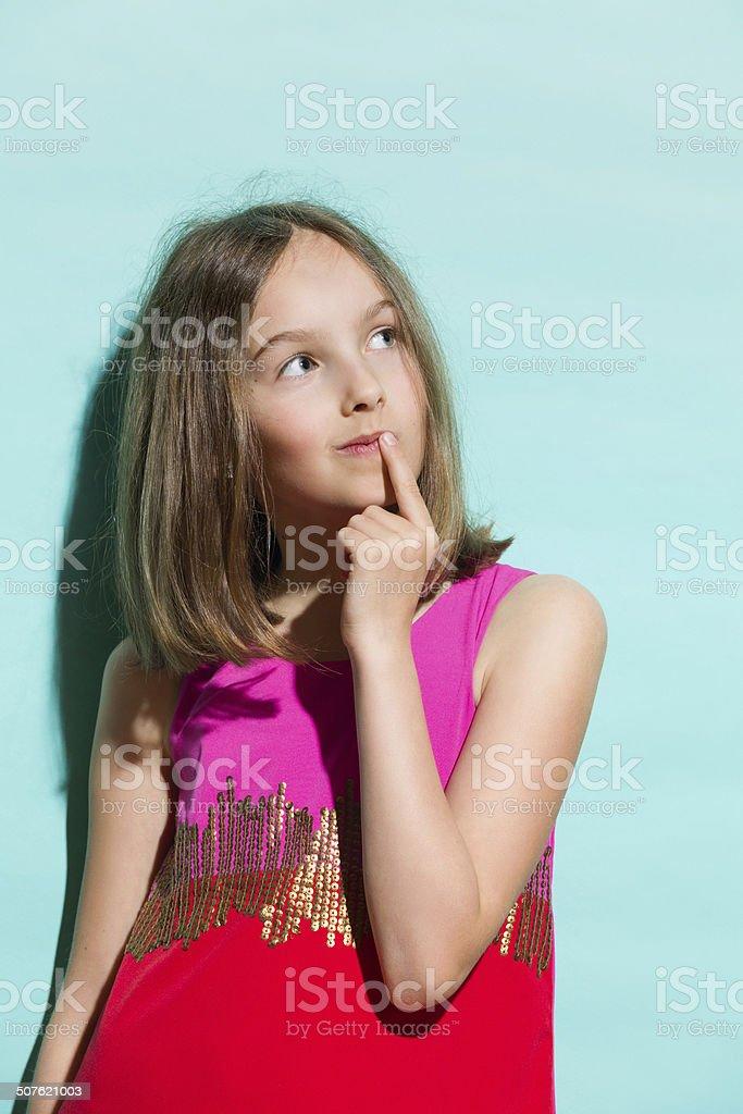 Little fashion model thinking stock photo