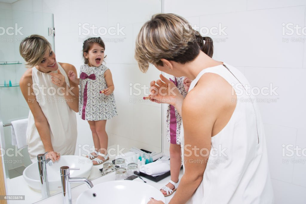 Little fashionista using lipstick royalty-free stock photo