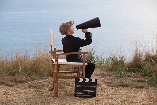little film director in aktion - klappe hut stock-fotos und bilder