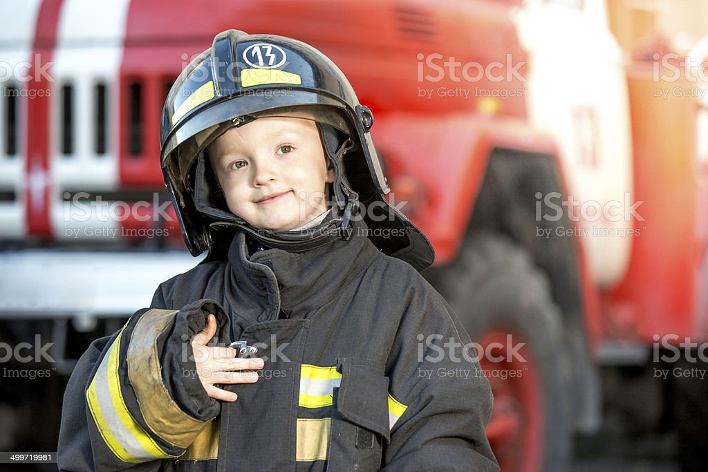 Little firefighter after of good work stock photo