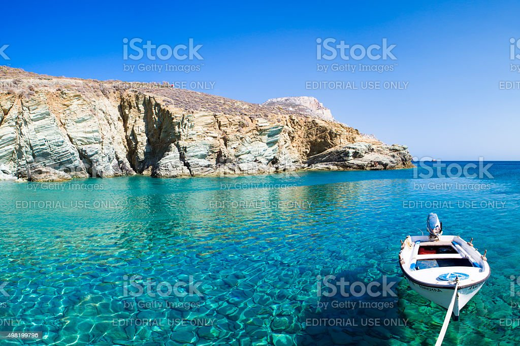 Little fisher wooden boat on the aegean sea stock photo