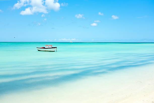 little fishing boat in the caribbean sea on aruba island - aruba stockfoto's en -beelden