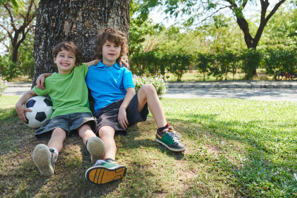 Little football players in park stock photo