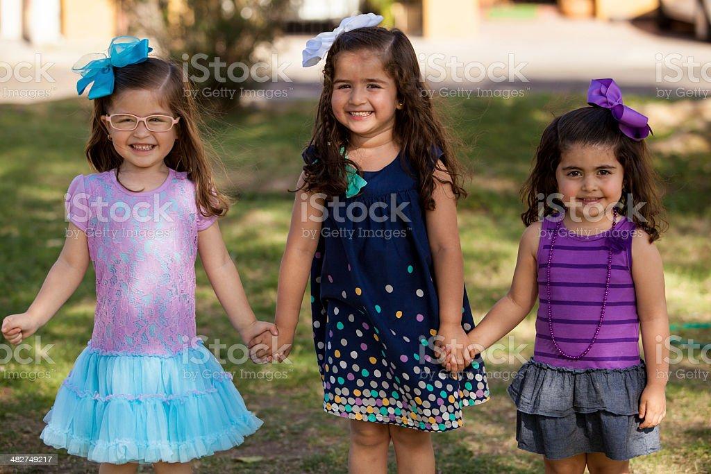 Little friends having fun in a park stock photo