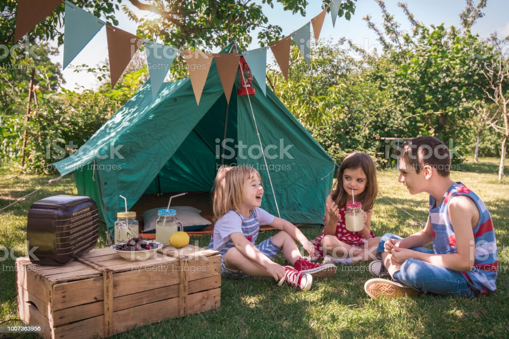Little friends having picnic Garden party. Summer fun Boys Stock Photo