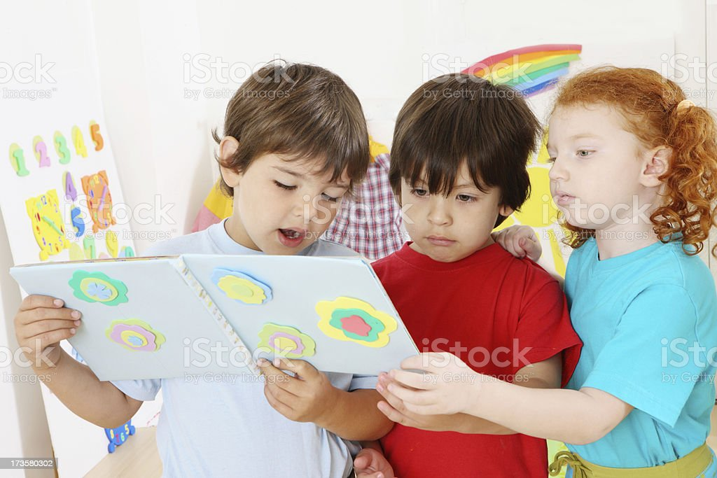 little friends reading a book royalty-free stock photo