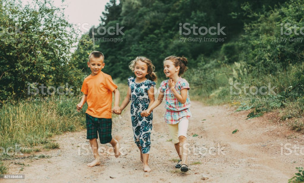 Little friends walking outdoors stock photo