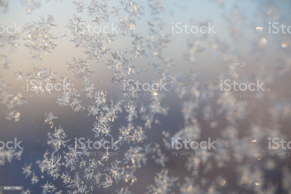 Little frosty patterns on glass, stock photo