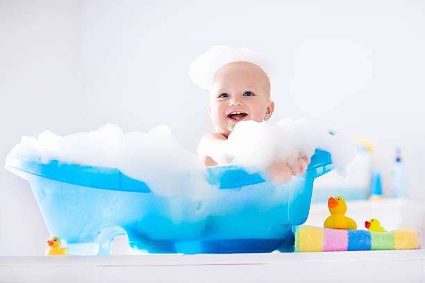 little funny baby taking a bath - baby bathtub bildbanksfoton och bilder