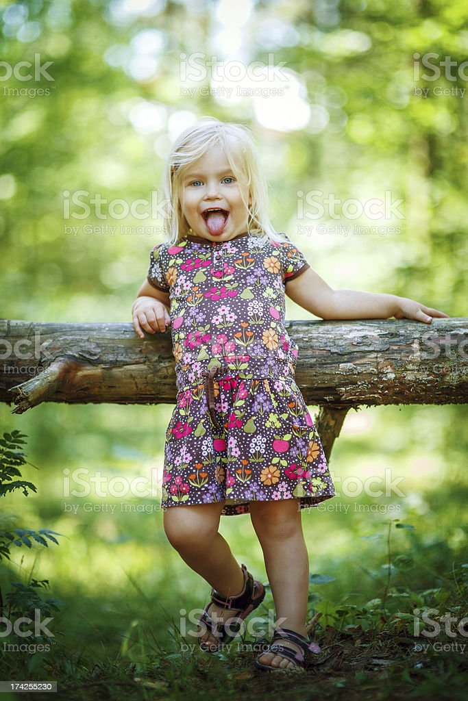Little funny girl in the forest royalty-free stock photo