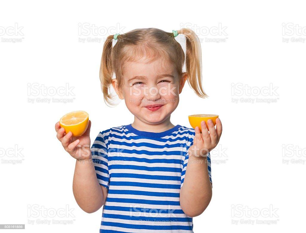 Little Funny girl keeps lemons stock photo