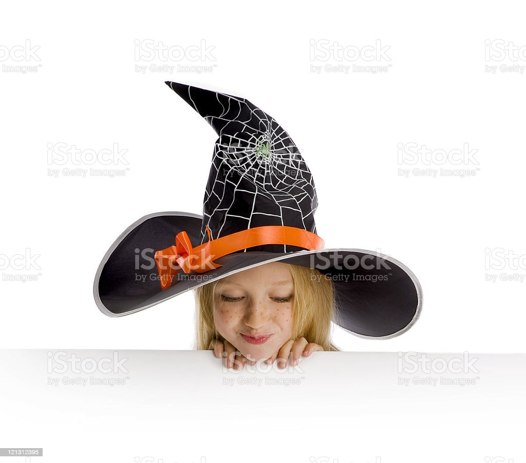 Little funny witch holding a sign. royalty-free stock photo