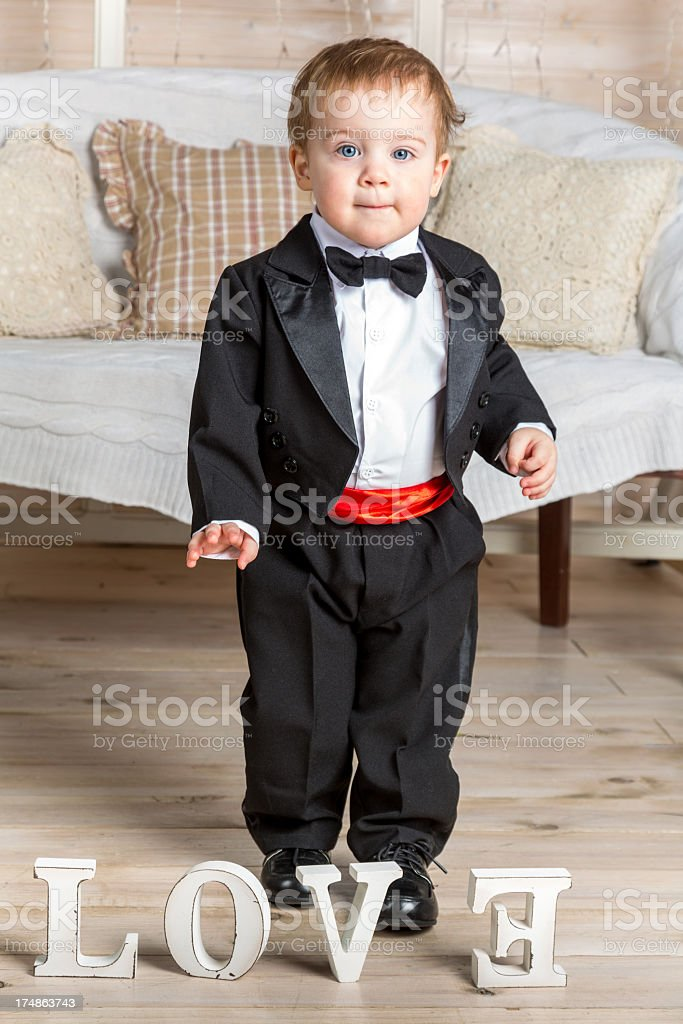 Little gentleman in waiting for new love royalty-free stock photo