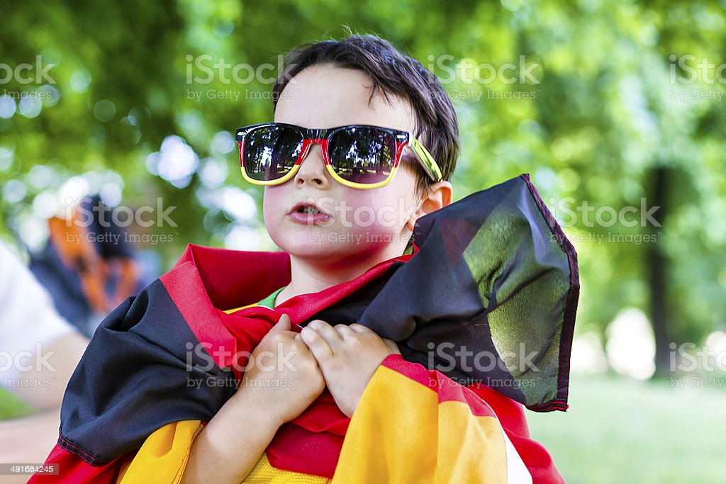 Little german supporter sings national anthem royalty-free stock photo
