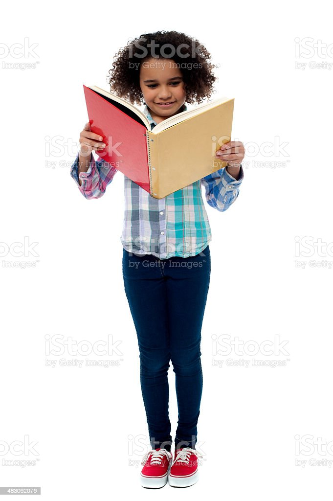 Little girl a reading book royalty-free stock photo