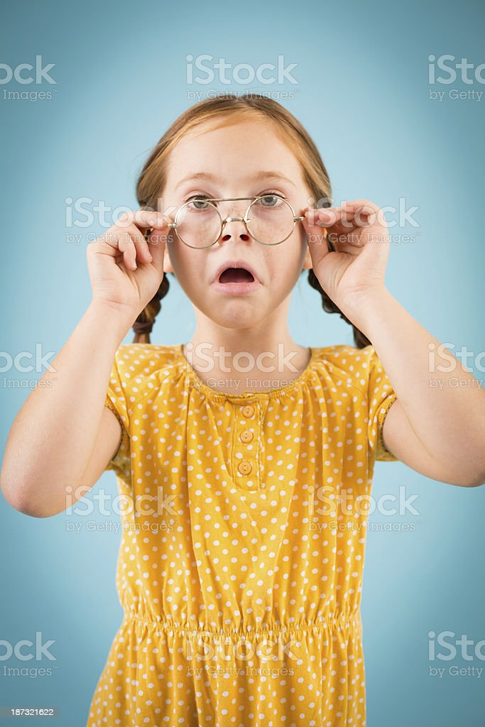 Little Girl Adjusting the Vintage Nerdy Glasses She is Wearing royalty-free stock photo