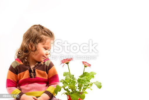 istock Little girl admiring flowers 494427152
