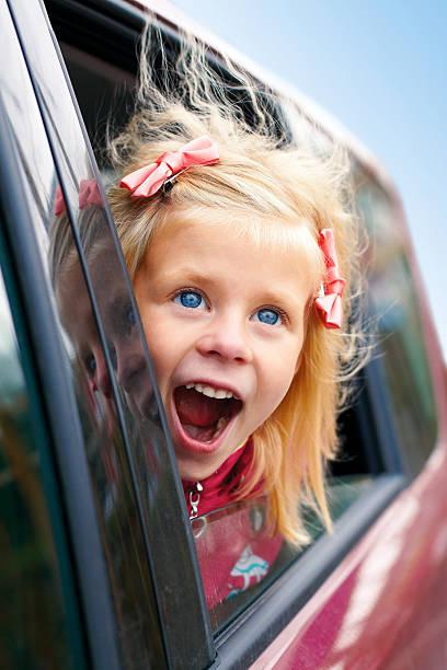 Little girl admiring looks of the car stock photo