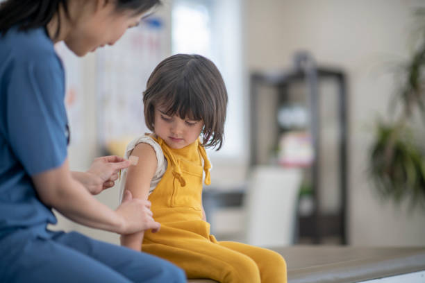 Little girl after immunization stock photo