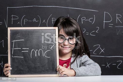 622006346 istock photo Little girl against blackboard. 533194725