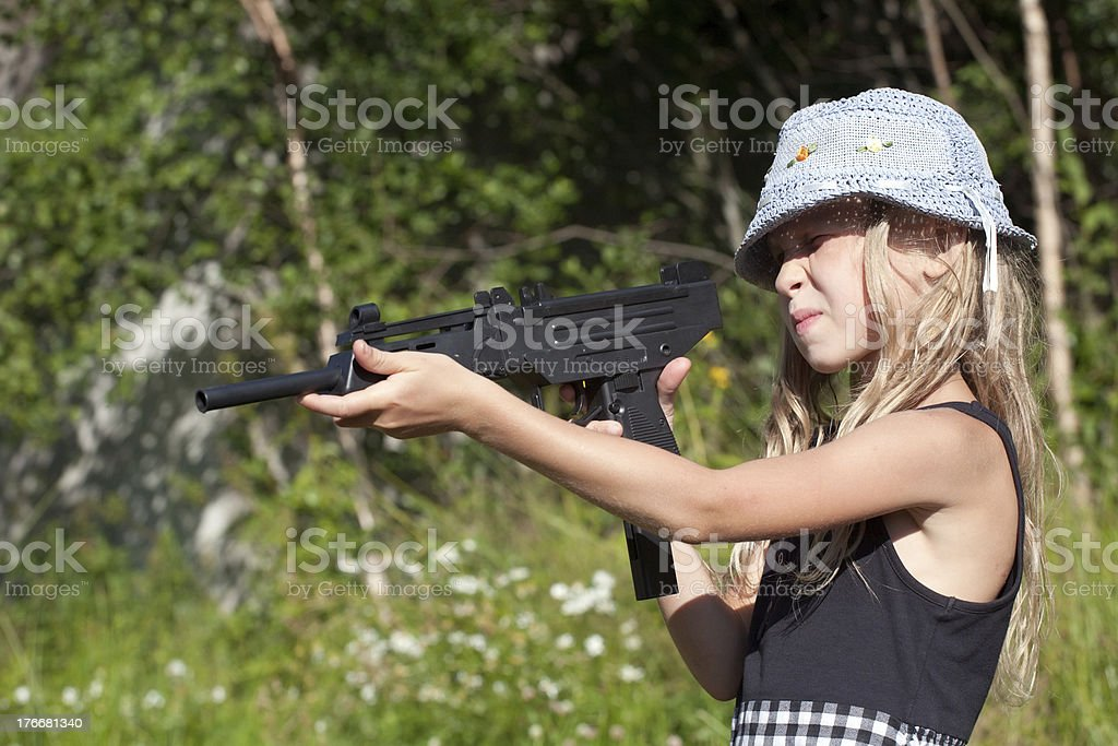 little girl aiming a big gun royalty-free stock photo