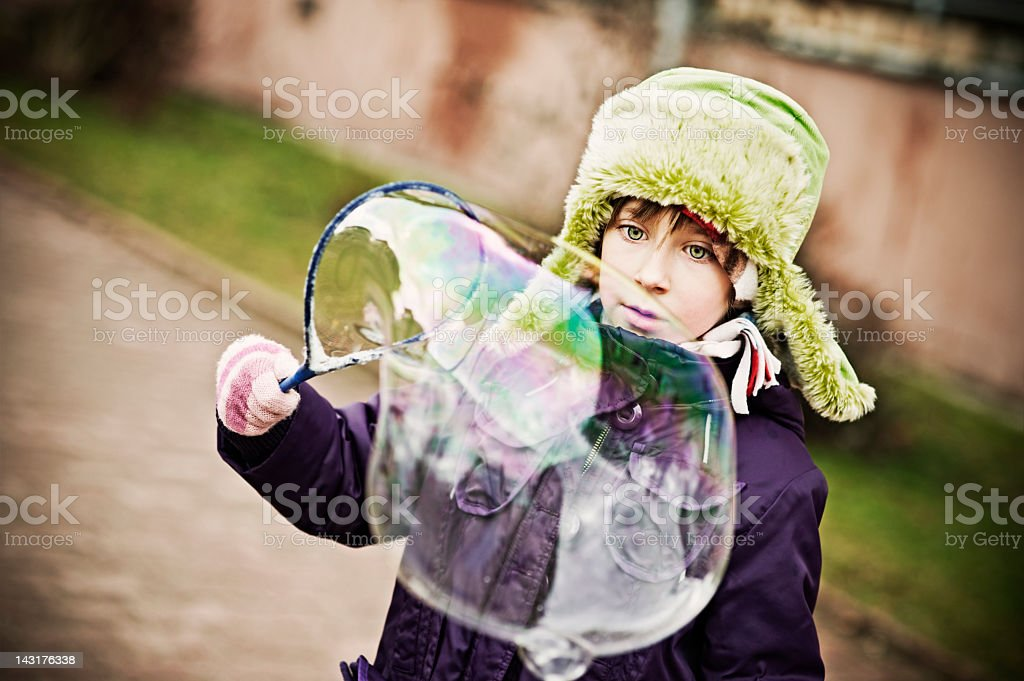 LIttle girl and a big bubble stock photo