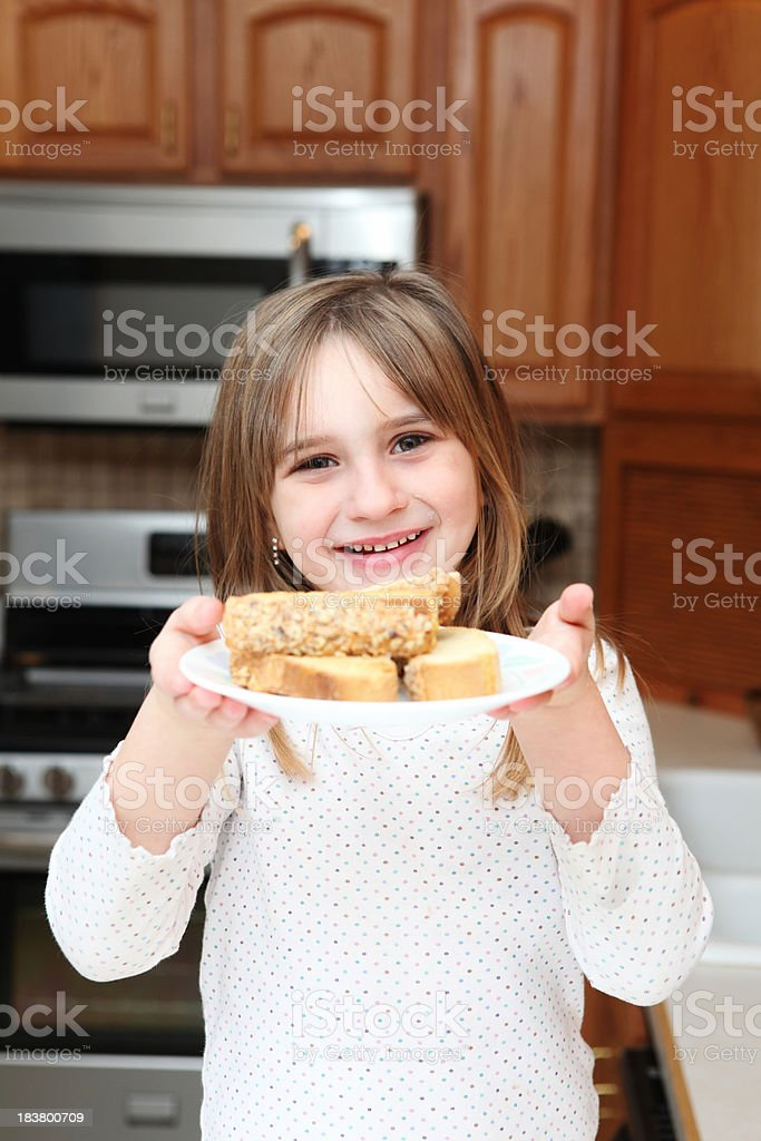Little girl and biscotti royalty-free stock photo
