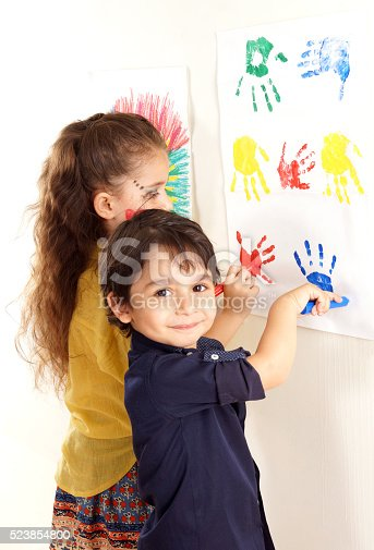 istock little girl and boy are doing paint 523854800