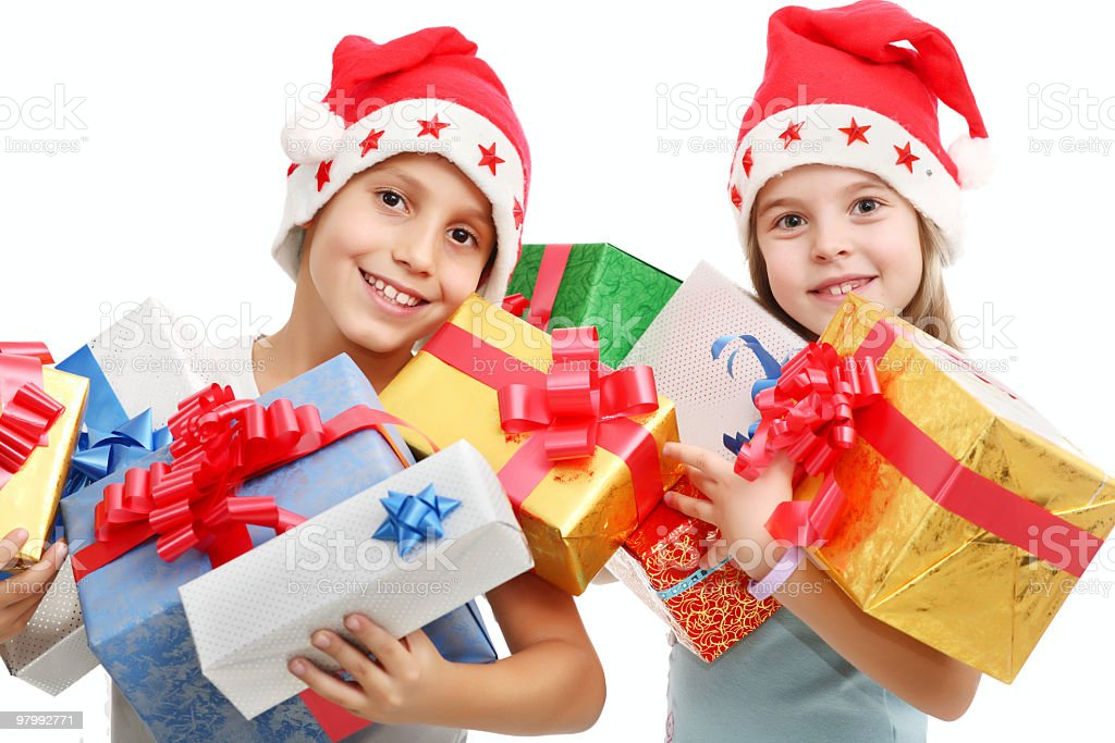 little girl and boy with xmas presents royalty-free stock photo