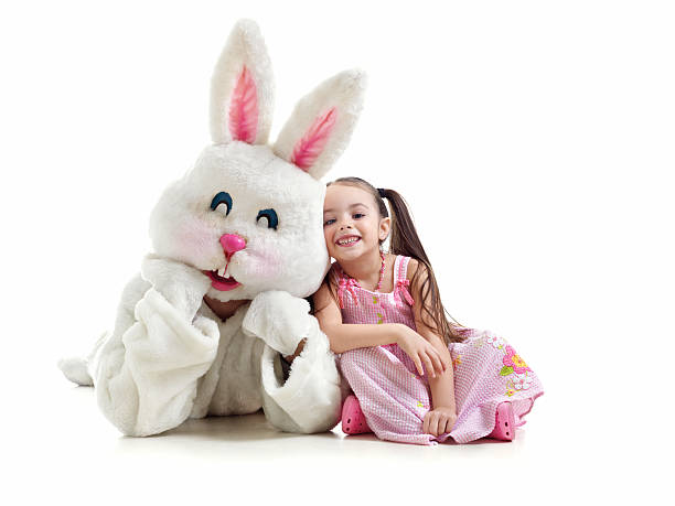 little girl and bunny fighting - easter bunny stock photos and pictures