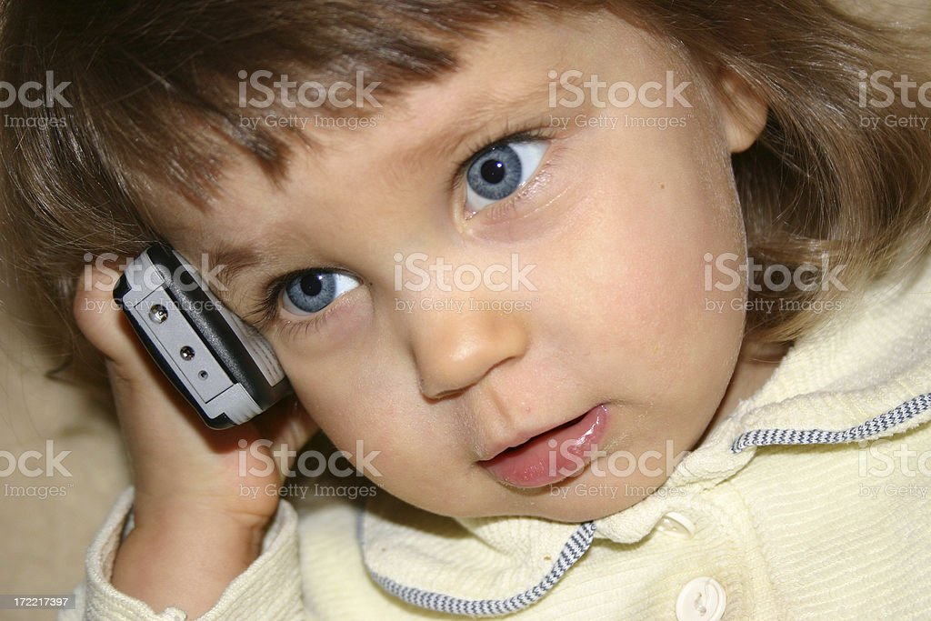 Little Girl and cel phone royalty-free stock photo