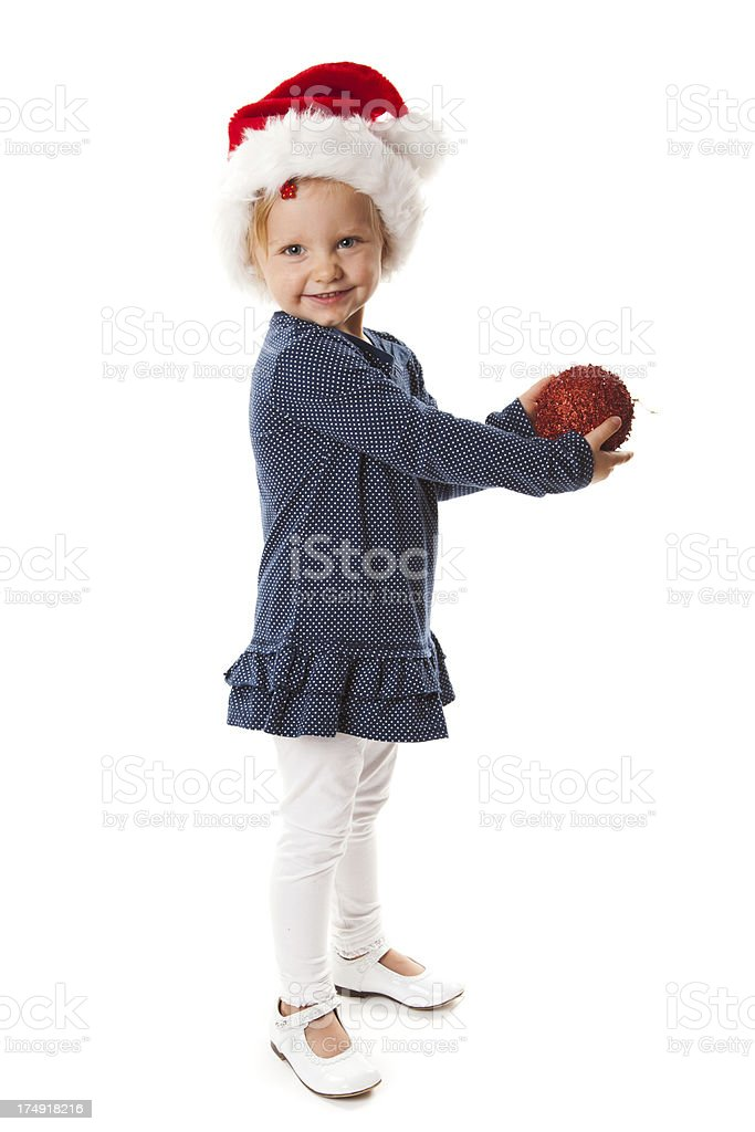 Little girl and Christmas decorations royalty-free stock photo