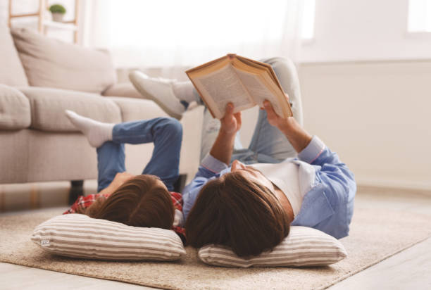 Little girl and father enjoying book together laying on floor picture id1192255969?b=1&k=6&m=1192255969&s=612x612&w=0&h=h4stdfkxofhly8xd 0buwaih816nrx2xcitcwxyakws=