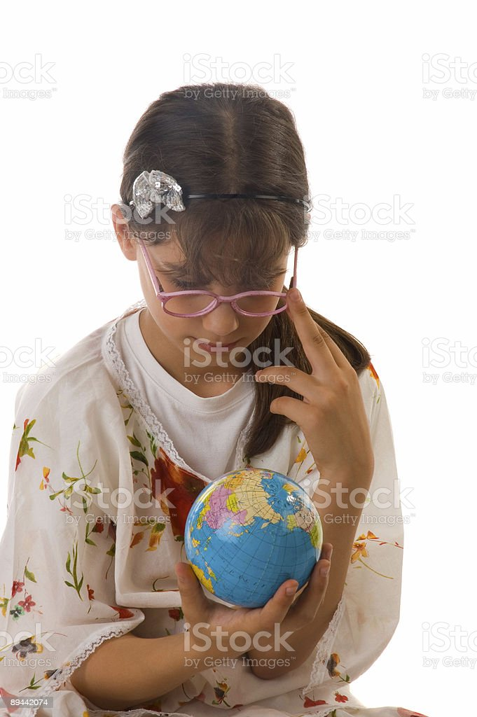 little girl and globe royalty-free stock photo