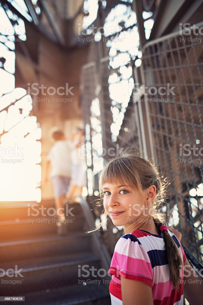 Little girl and her brothers climbing stairs of Eiffel Tower stock photo