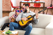 istock Little girl and her father with funny sunglasses at home 993487120