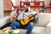 istock Little girl and her father with funny sunglasses playing instruments 1010054822