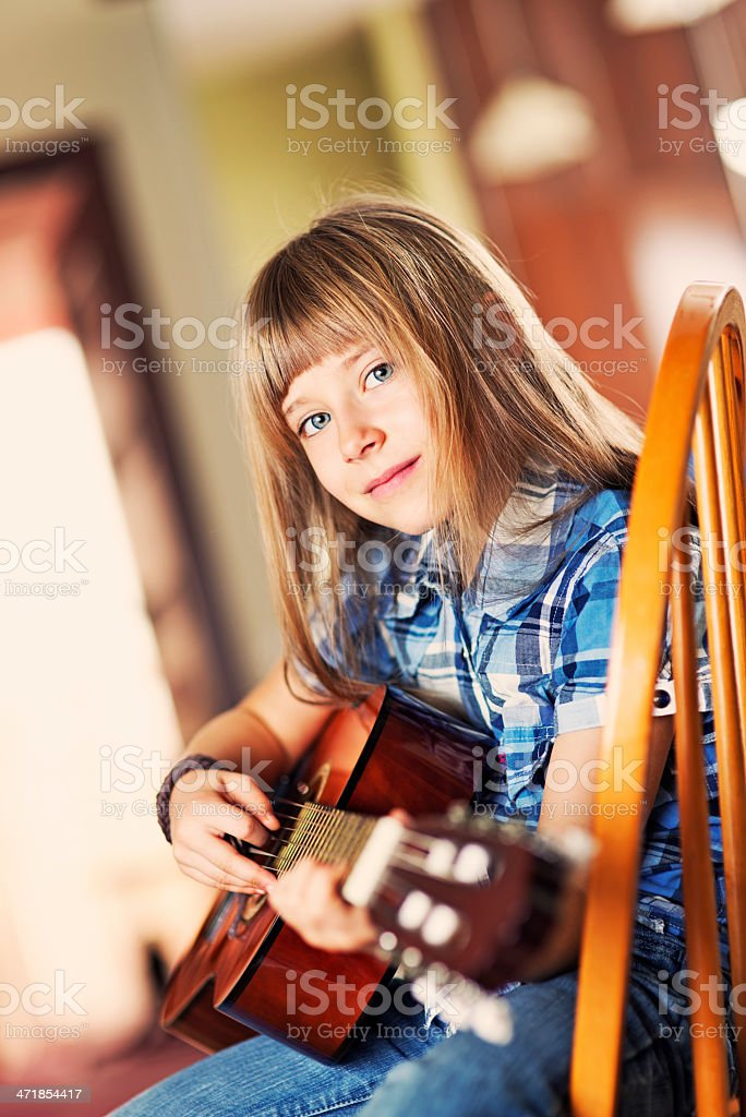 Little girl and her guitar royalty-free stock photo