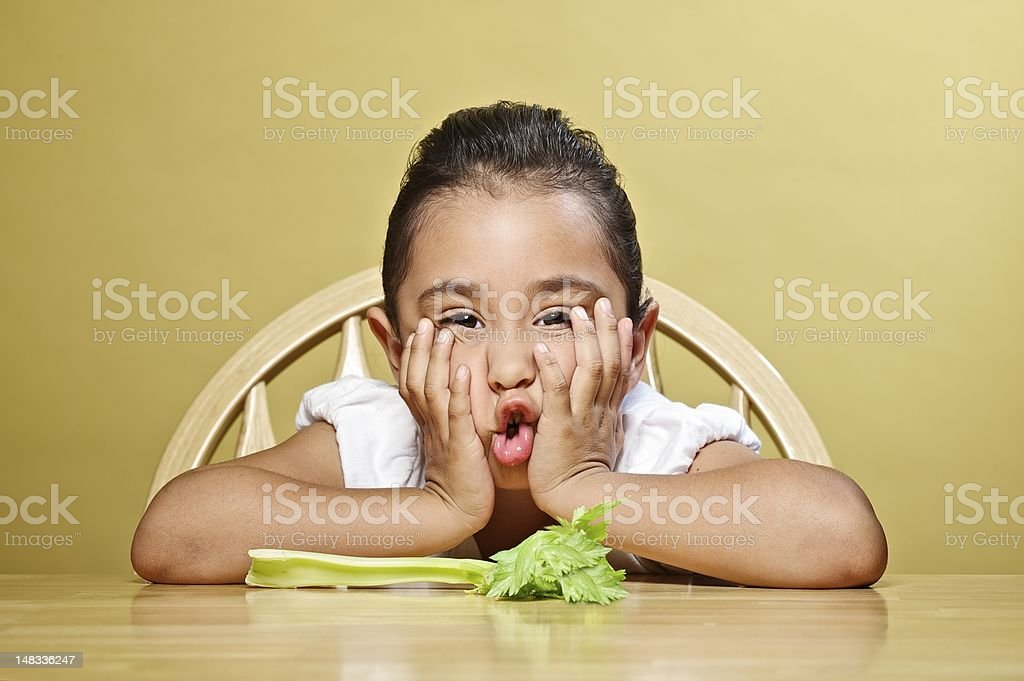 Little girl and her healthy snack royalty-free stock photo